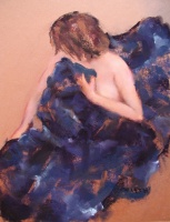 Short brown haired woman wrapped in blue blanket