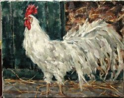 White rooster with red crown. Hay and washed out greenish barn door in background