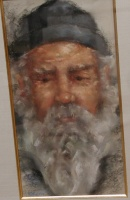 Old white bearded man's face with a grey winter hat.