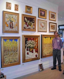 A photo of a wall of Wieth paintings in a gallery