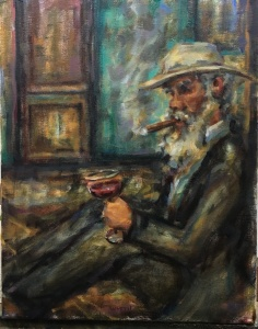 An old man sitting against a wall with a cigar in his mouth, hat, suit and glass of red wine.